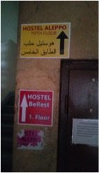 A sign for a hostel catering to Syrians.
